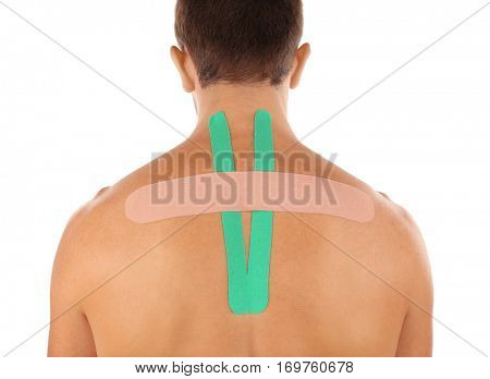 Male back with applied physio tape, isolated on white