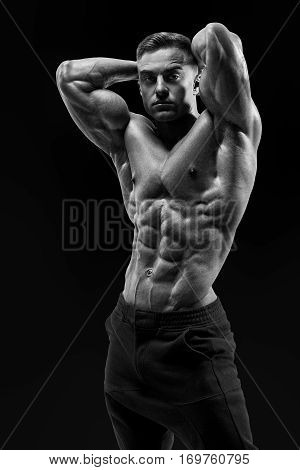 Shirtless Male Bodybuilder With Muscular Build Strong Abs Showing