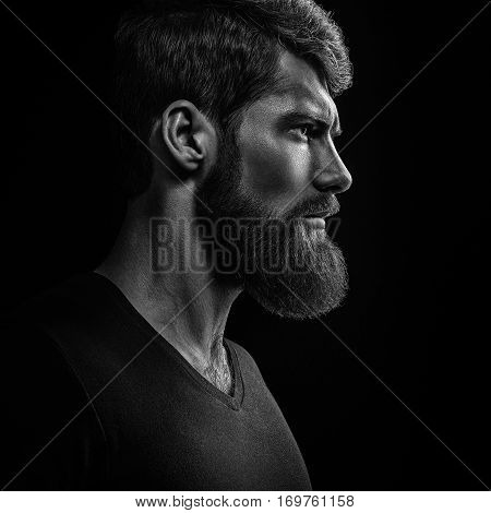 Black And White Close-up Portrait Of Young Handsome Bearded Man Looking Forward