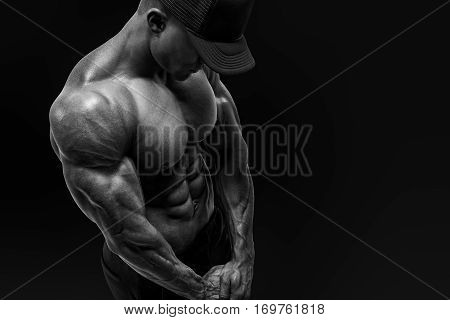 Shirtless Male Bodybuilder With Muscular Build Strong Abs Showing.