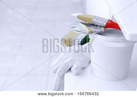 Set of painter tools on ladder, closeup