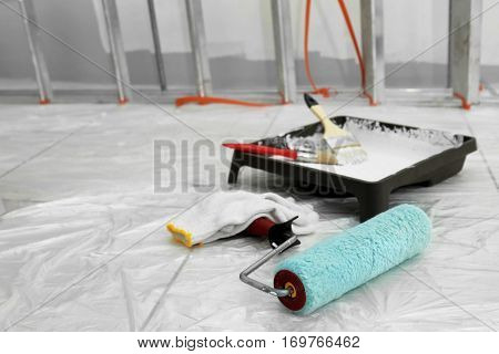 Set of painter tools on floor