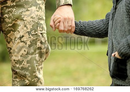 Soldier reunited with his family,closeup