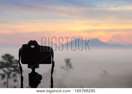 DSLR Camera capturing beautiful landscape view in morning