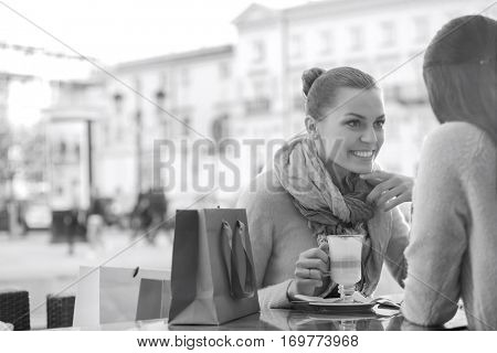 Female friends at sidewalk cafe