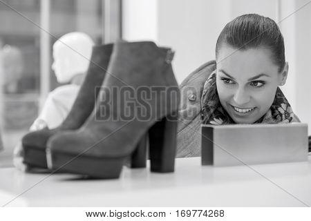 Woman admiring footwear in store