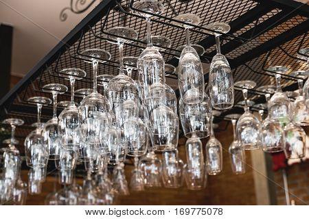 Wine glass hanging oh shelf in pub & restaurant