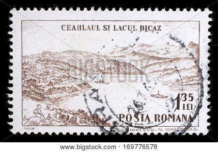ZAGREB, CROATIA - JULY 18: stamp printed by Romania, shows Ceahlaul peak and Lake Bicaz, circa 1964, on July 18,2012.