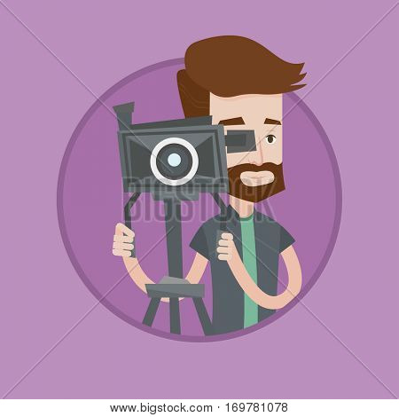 Caucasian hipster cameraman with beard looking through video camera on a tripod. Young cameraman with professional video camera. Vector flat design illustration in the circle isolated on background.