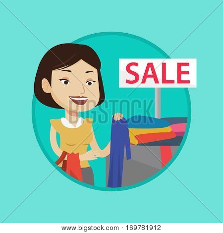 Girl buying clothes at store on sale. Caucasian woman choosing clothes in shop on sale. Girl shopping in clothing shop during sale. Vector flat design illustration in the circle isolated on background