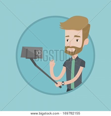 Hipster man making selfie with a stick. Man making photo with a selfie-stick. Young man making selfie and waving his hand. Vector flat design illustration in the circle isolated on background.