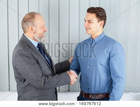 Picture of a senior employer giving a chance to a young adult