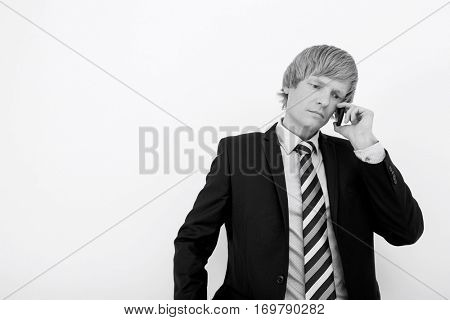 Senior mid adult businessman using cell phone over white background