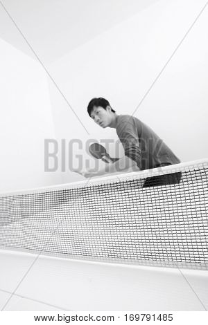 Table tennis player preparing to serve
