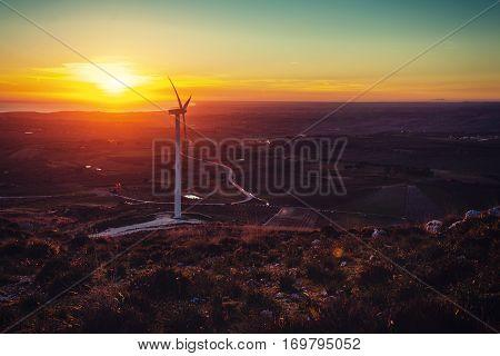 Solar wind turbines at sunset. Retro style filter.