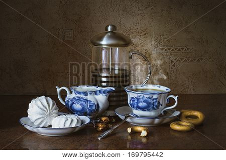 still life of tea with marshmallows and chocolates Breakfast still life still life morning painting   still life tea tea and dessert
