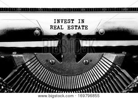 INVEST IN REAL ESTATE Typed Words On a Vintage Typewriter Conceptual