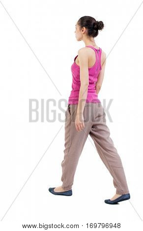 back view of walking  woman. beautiful curly girl in motion.  backside view of person.  Rear view people collection. Isolated over white background. woman with hair tied in a bundle of leaves