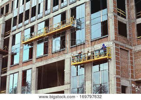 Group of workers installing windows