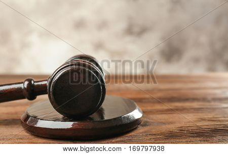 Court gavel and sound block on table