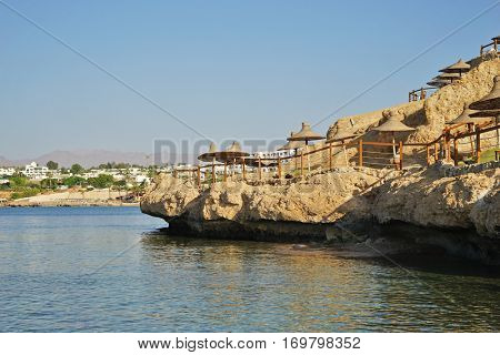 Comfortable beach on a rock in a luxury resort