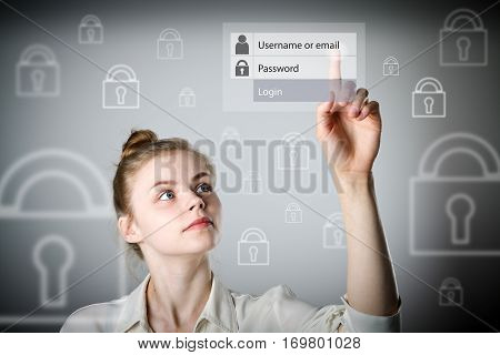 Girl in white is pushing the virtual button. Login and password concept. Young slim woman.