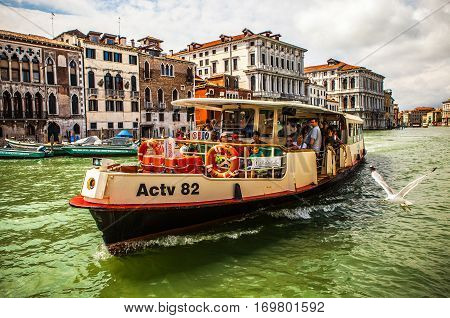 VENICE ITALY - AUGUST 17 2016: Vaporetto (passanger boat) at Grand Canal in Venice on August 17 2016 in Venice Italy.