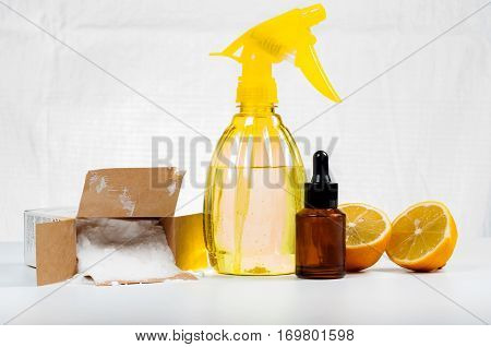 Eco-friendly natural cleaners made of lemon and baking soda on white wooden table