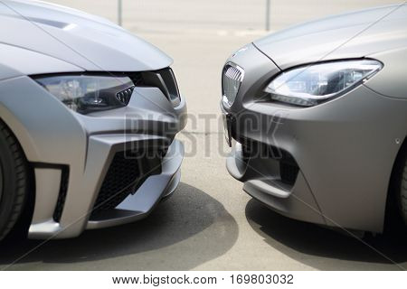 MOSCOW - JUN 19, 2016: Two sport model car BMW gray colored standing opposite each other