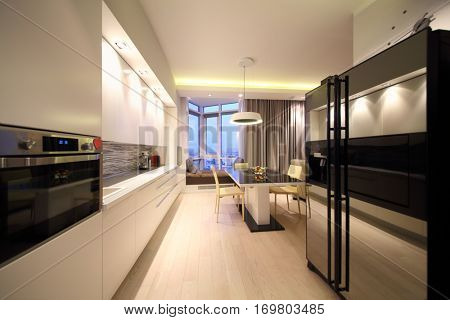 Kitchen interior with dining area and bay window in a modern flat