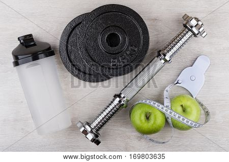Disassembled Dumbbell, Plastic Shaker, Green Apples And Measures Tape