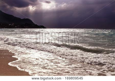 Oceanbefore a thunderstorm with beautiful purple sky expressive seascape