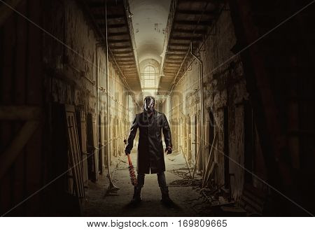 Killer with bloody bat in abandoned building.