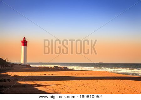 Umhlanga Lighthouse on the Indian Ocean Shore in Durban, South Africa.