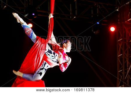 Bangkok, Thailand - February 20 2016: Jinan Acrobatic Troupe Performing In Rama Ix Park In A Chinese
