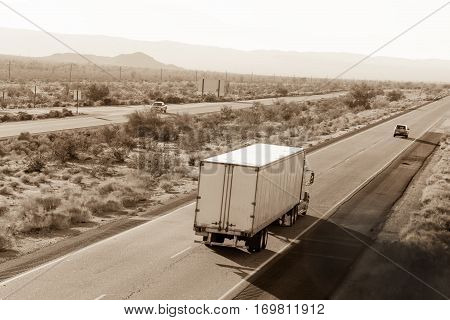 Cross-country traffic on Interstate I-10 through the desert in California