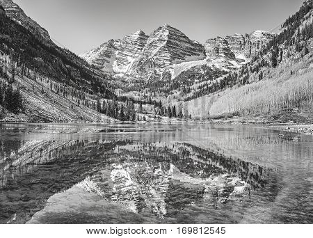 Black And White Picture Of Maroon Bells Reflected In Lake.
