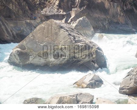 Tiger Leaping Gorge is a scenic canyon on the Jinsha River a primary tributary of the upper Yangtze River.