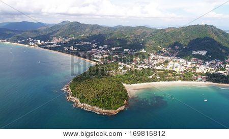 Aerial view of small island, long tail boats on the sea near Kata beach in Phuket, Thailand