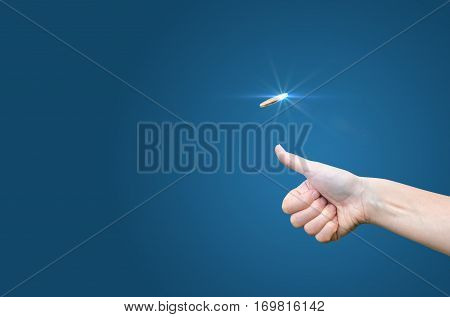 Hand Throws A Coin On A Blue Background To Make The Decision