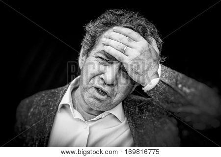 Grief. Sad man. Black and white portrait