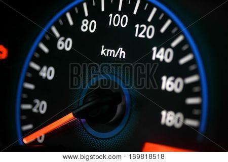 Car speedometer in blue and orange neon light