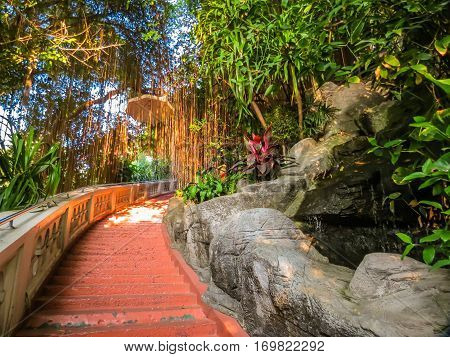 Huge staircase to an entrance to the Wat Saket Temple at sunrise. Buddhist Temple Wat Saket or Golden mount, Bangkok, Thailand. Selective focus
