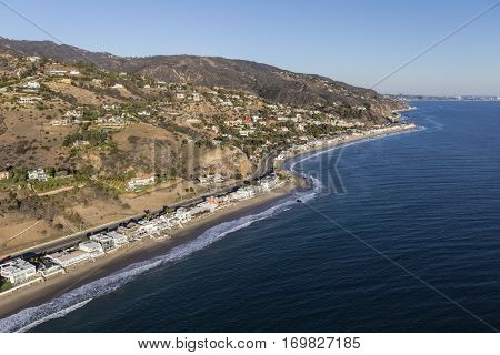 Aerial of Pacific coast homes and mountains in Malibu California.