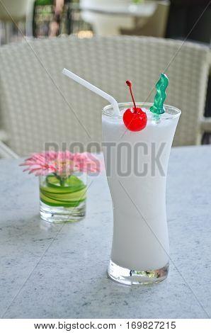 Closeup squeeze coconut juice with cherry decoration