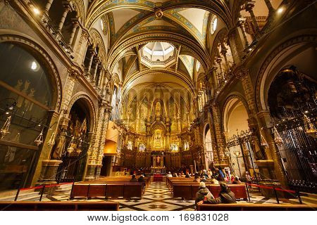 Barcelona Spain - January 06 2017: Some people visit to church of the Benedictine monastery of Santa Maria de Montserrat is lies about 45 km northwest of Barcelona