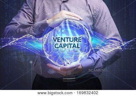 Business, Technology, Internet And Network Concept. Young Businessman Shows The Word: Venture Capita