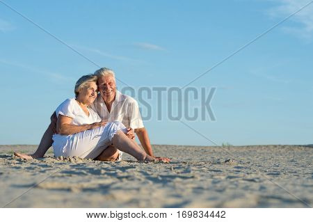 Portrait of a happy olderly woman holding gift