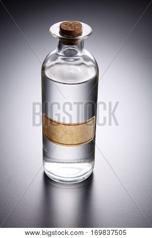 bottle of clear liquid unlabel