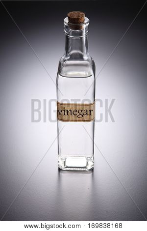 bottle of vinegar on the gray background
